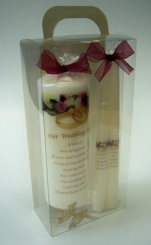 A packaged set of 3 wedding candles: 1 large and two stick candles.
