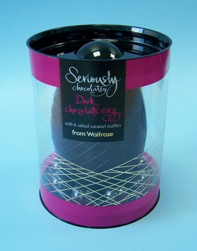 black and purple luxury chocolate easter egg in cylindrical acetate box