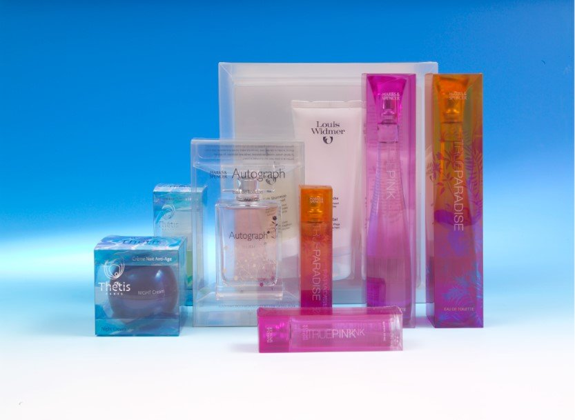 A collection of beauty products in clear plastic packaging