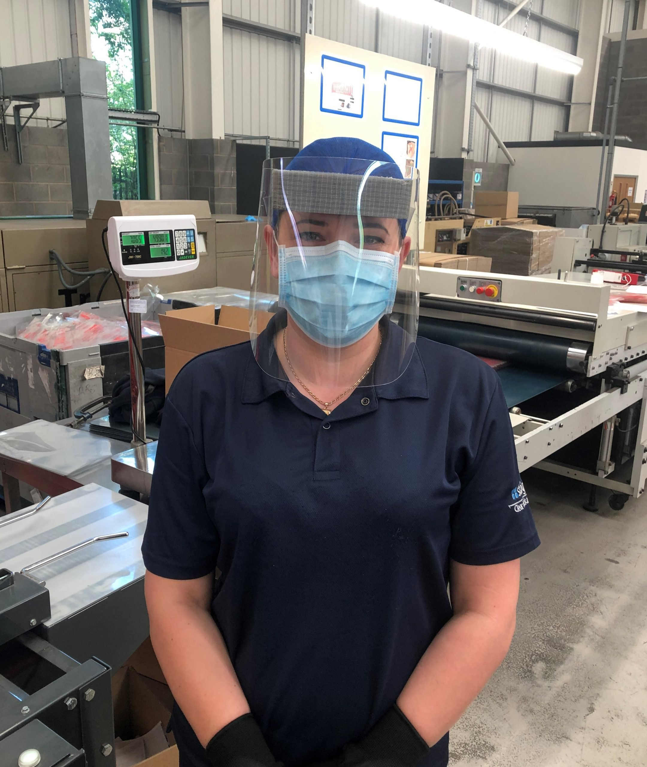 A photograph of Staeger worker modelling the new Deluxe face Visor with foam for the NHS PPE supplies.